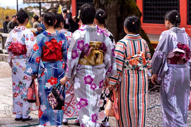 Women wearing Japan kimono walking in front of Kiyomizu-dera temple in Kyoto, Japan