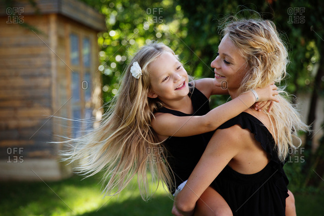 Mother spinning with daughter in her arms