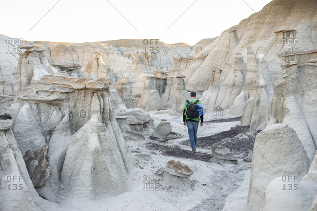Hiking around hoodoo sandstone formations in Bisti/De-Na-Zin Wilderness, New Mexico.