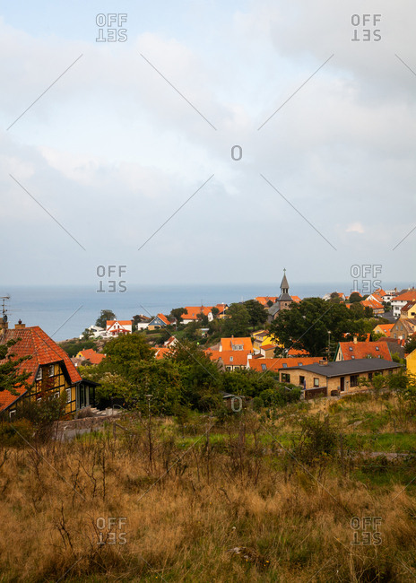 View over coastal town with red roof buildings