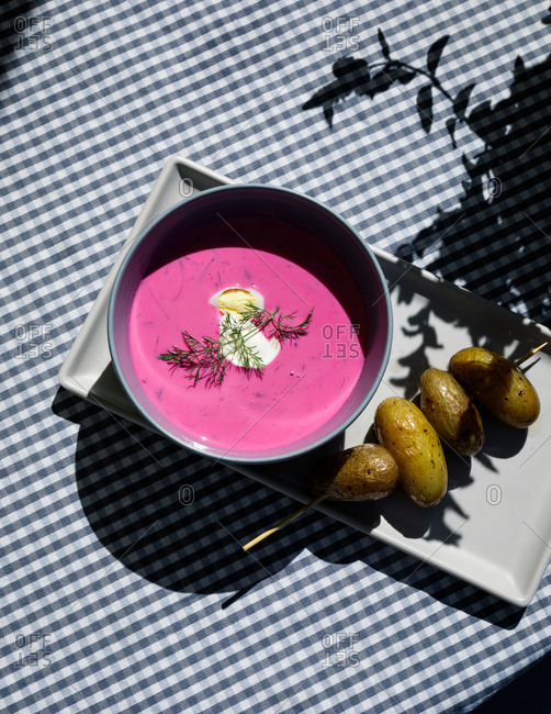 Overhead view of cold beet soup with pickles