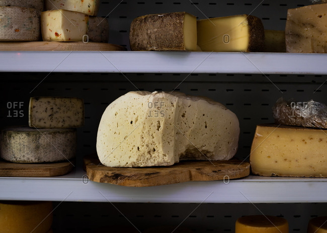 Variety of cheeses on shelves