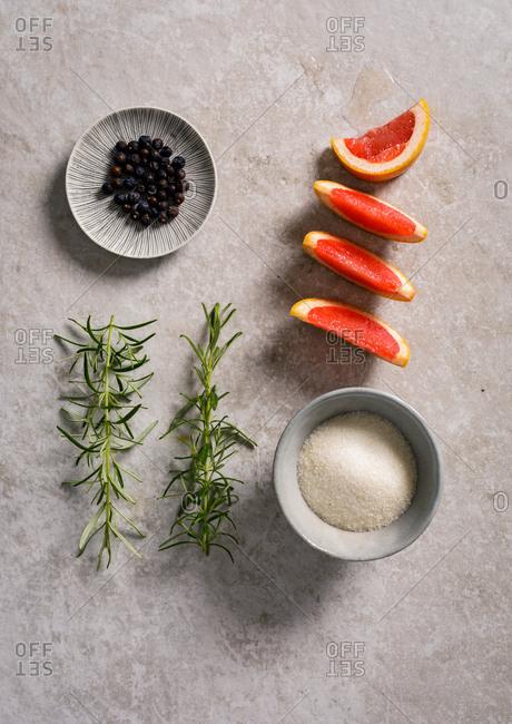 Salt, peppercorns, grapefruit and rosemary