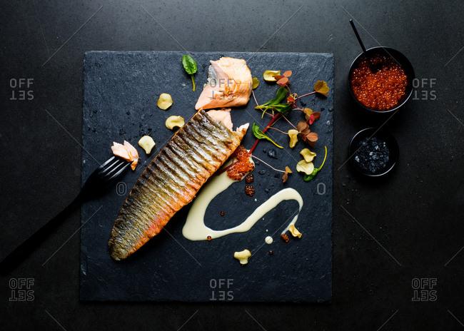 Grilled salmon on slate board