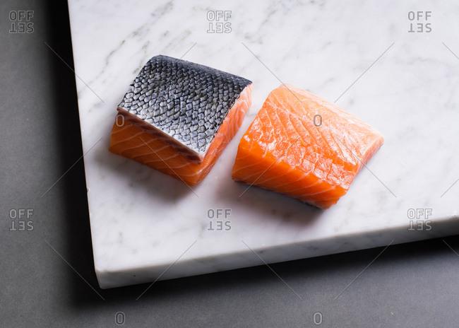 Raw salmon on white marble slab