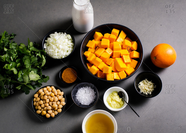 Butternut squash and other ingredients on gray surface