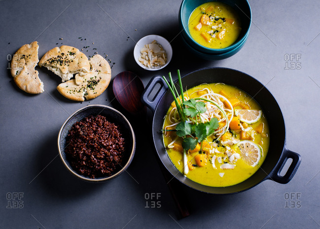 Overhead view of butternut squash soup on gray background