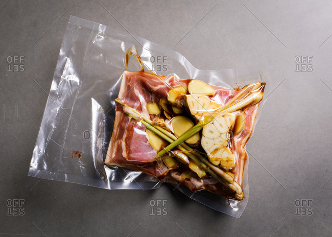 Raw ingredients in a sealed bag on gray surface