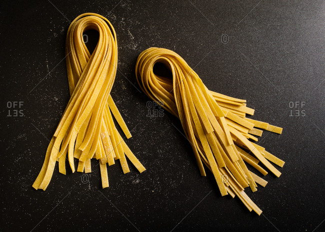 Raw noodles on black background