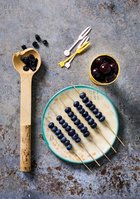 Blueberries on skewer sticks