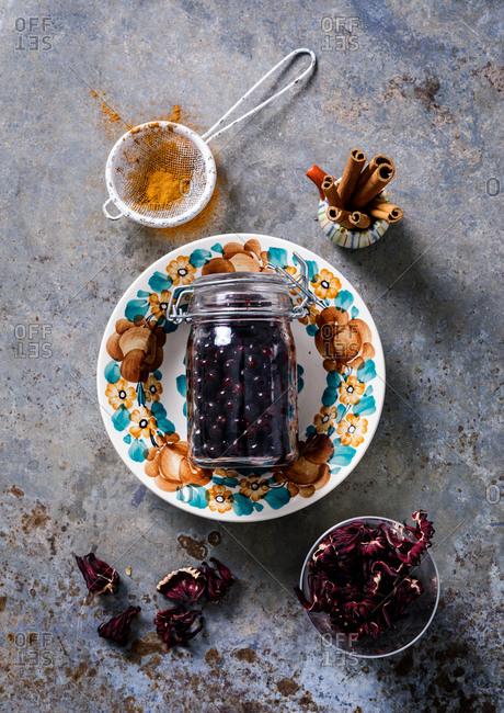 Overhead view of blueberries in a glass jar