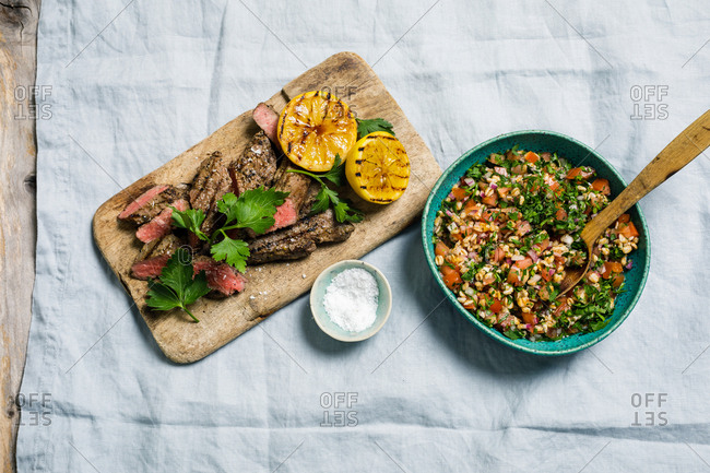Tri-tip steak with food tabouleh with garlic and chili