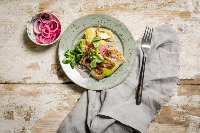 Za'atar baked cod in puree with potato and crown chard salad