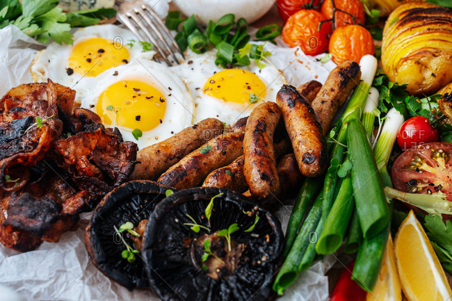 Full frame shot of eggs, sausage and veggies