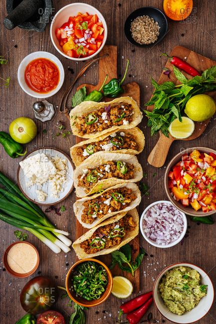 Overhead view of tacos on rustic wooden surface