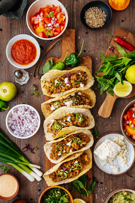 Top view of tacos on rustic wooden surface