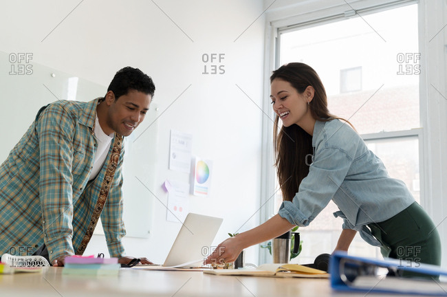 Business people working together at office desk