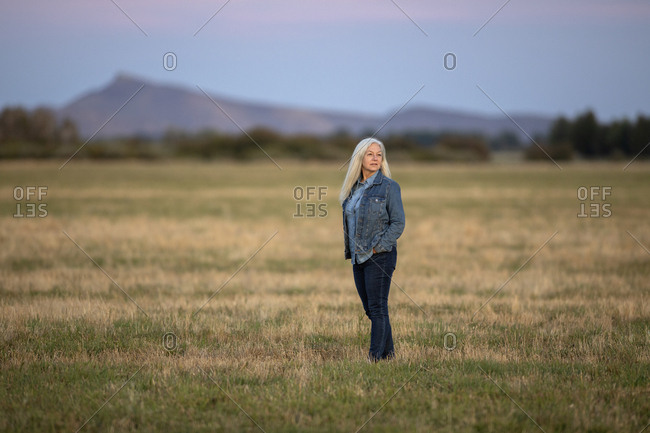 Woman in field in Picabo, Idaho, USA