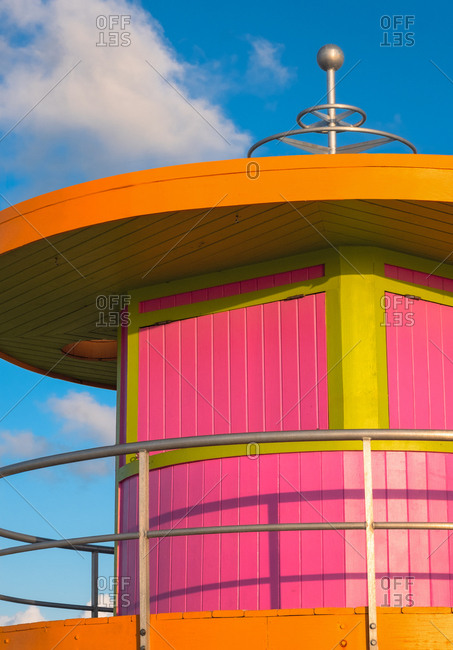 Pink and orange beach hut against sky in Miami, Florida, USA