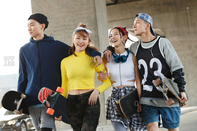 Two couples skateboard together