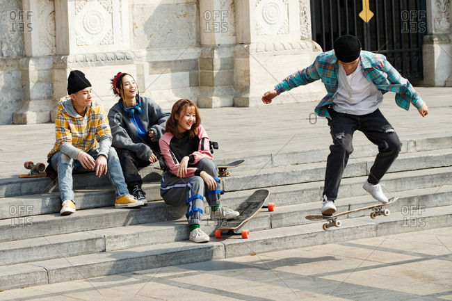Four skaters show off their moves to one another