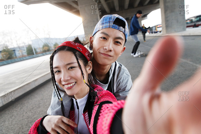 Young couple smiles at the camera together