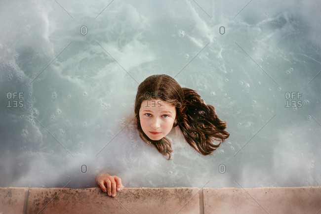 Overhead view of a girl in a hot tub