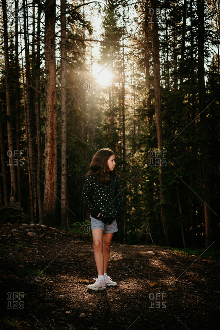 Portrait of a girl walking in the forest
