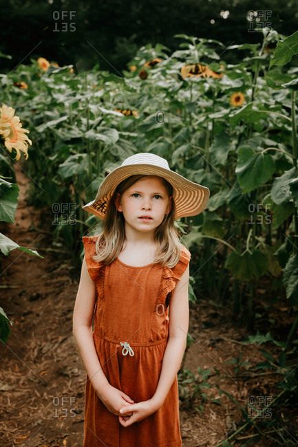 Young girl in a sunflower field