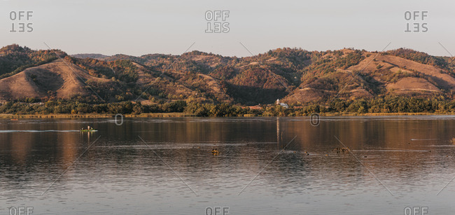Beautiful panoramic view of hills over a river at sunset