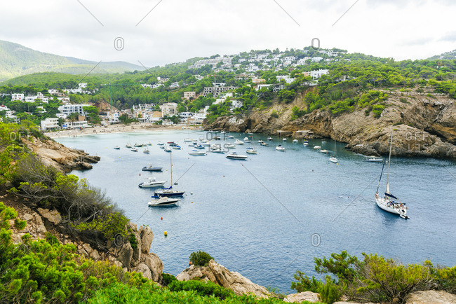 Ibiza, Balearic Islands, Spain - September 14, 2019: Landscape with sport boats in Cala Vadella in Ibiza