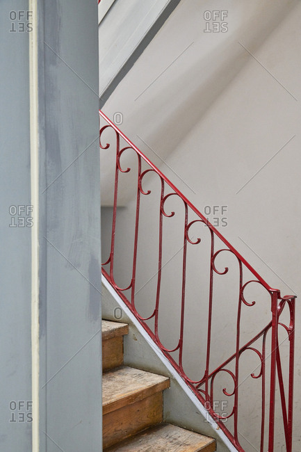 Stairs with red railing in a building, Lisbon, Portugal