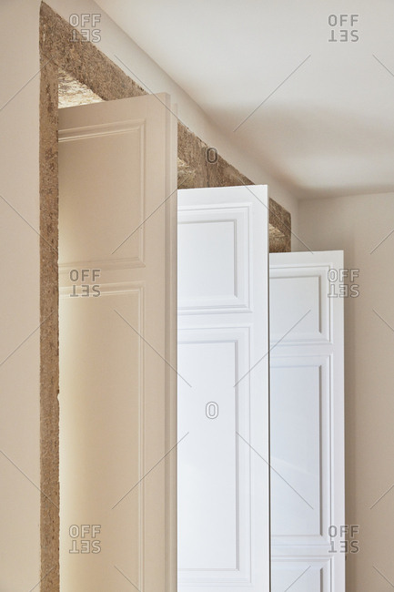 White wooden doors on interior of building in Lisbon, Portugal