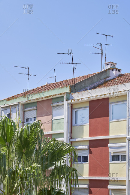 Multicolored facades of apartment buildings with antennas on top, Lisbon, Portugal
