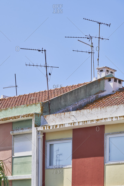 Multicolored apartment buildings with antennas on top, Lisbon, Portugal