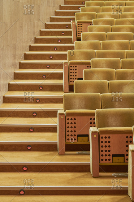 Stairs beside yellow auditorium chairs, Lisbon, Portugal