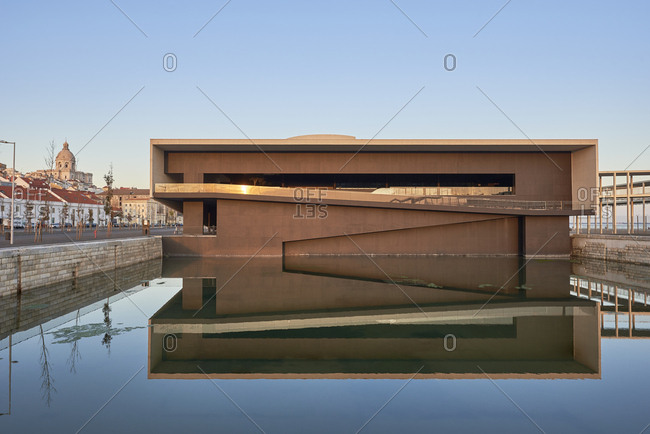 Lisbon, Portugal - December 4, 2019: The new Santa Apolonia Cruise Terminal reflecting in water