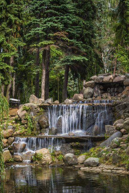 Poland- Masovian Voivodeship- Warsaw- Small waterfall in Skaryszewski Park