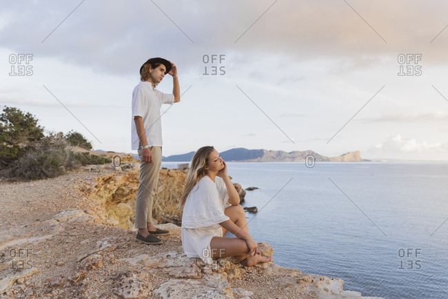 Young couple in front of the sea looking at distance- Ibiza- Balearic Islands- Spain