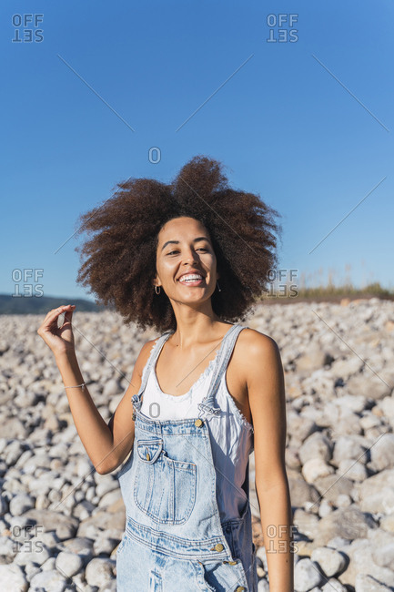 Portrait of young smiling woman on empty beach