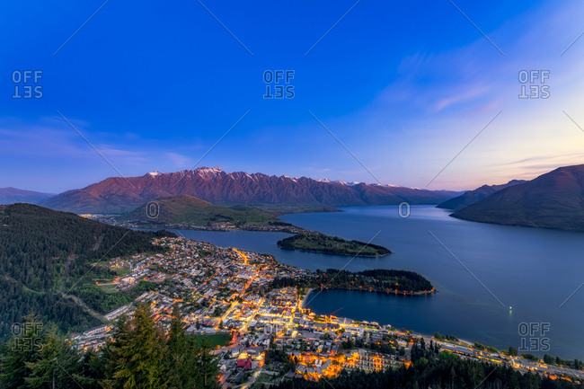 Illuminated buildings in Queenstown by Lake Wakatipu against at night- Queenstown- New Zealand
