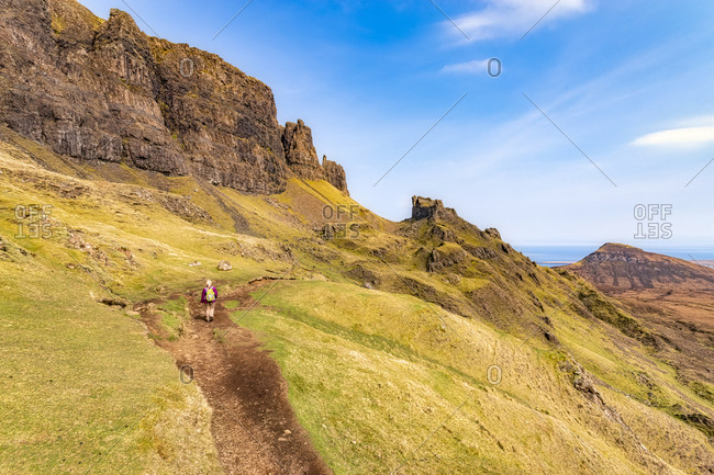 Rear view of mature woman hiking at Quiraing- Isle of Skye- Highlands- Scotland- UK