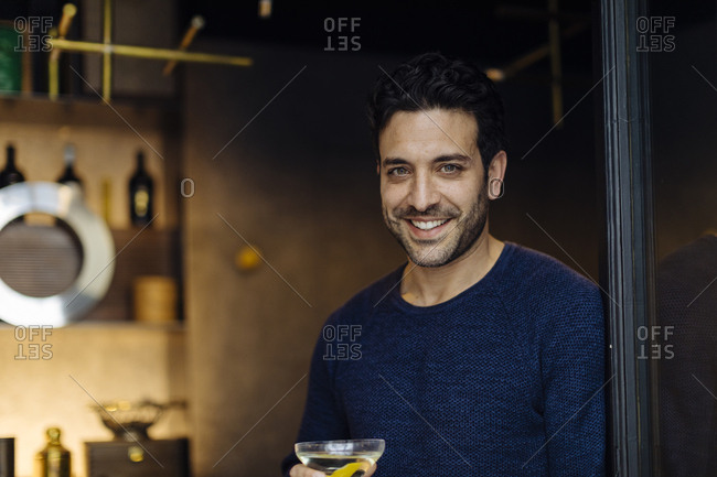 Businessman in stylish office- taking after work cocktail