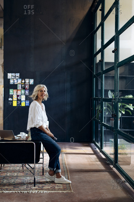 Portrait of casual mature businesswoman in loft office