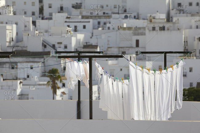 Spain- Andalusia- Conil de la Frontera- drying clothes with building in background