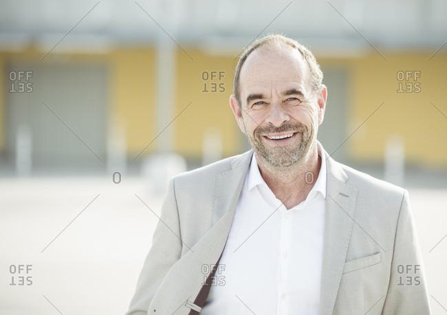 Portrait of happy mature businessman outdoors