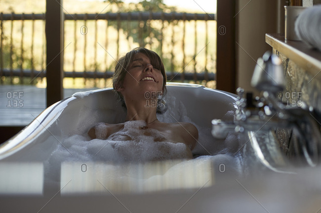 Woman having a relaxing bath in the bathtub