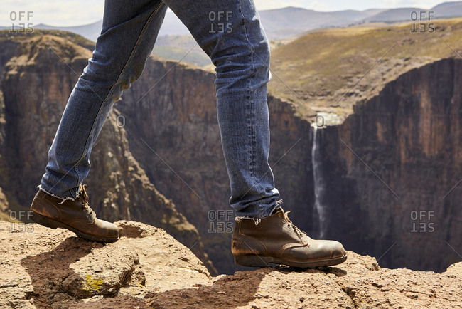 Low section of a man walking through the mountains- Maletsunyane Falls- Lesotho