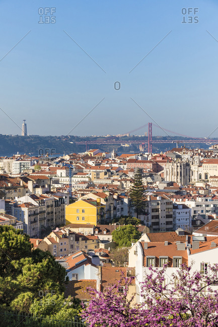 Buildings and April 25th Bridge against clear sky in Lisbon- Portugal