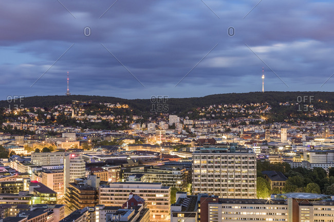 May 14, 2019: Illuminated buildings and communications tower against cloudy sky at dusk in Stuttgart- Germany